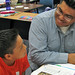 Jemez Day School teacher Patrick Lewis and young student.
