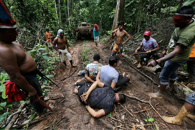 1_amazon-indians-strip-tie-beat-illegal-loggers.jpg