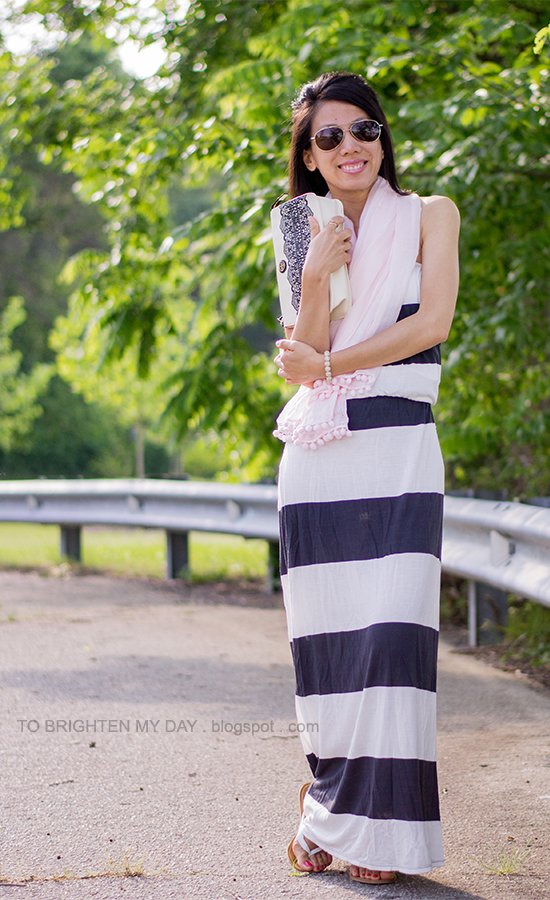 light pink scarf, striped maxi dress, lace printed clutch