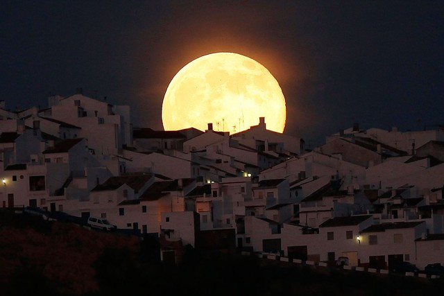 Super moon rises over houses