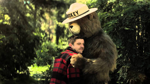 """Smokey Bear is the longest running public service campaign in the country. This year, the Ad Council helped develop the """"Bring it in for a hug"""" series, which shows Smokey hugging someone after they did a good deed that prevented a wildfire. (Advertising Council)"""