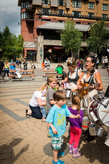 Kids enjoying Whistler Village street entertainment