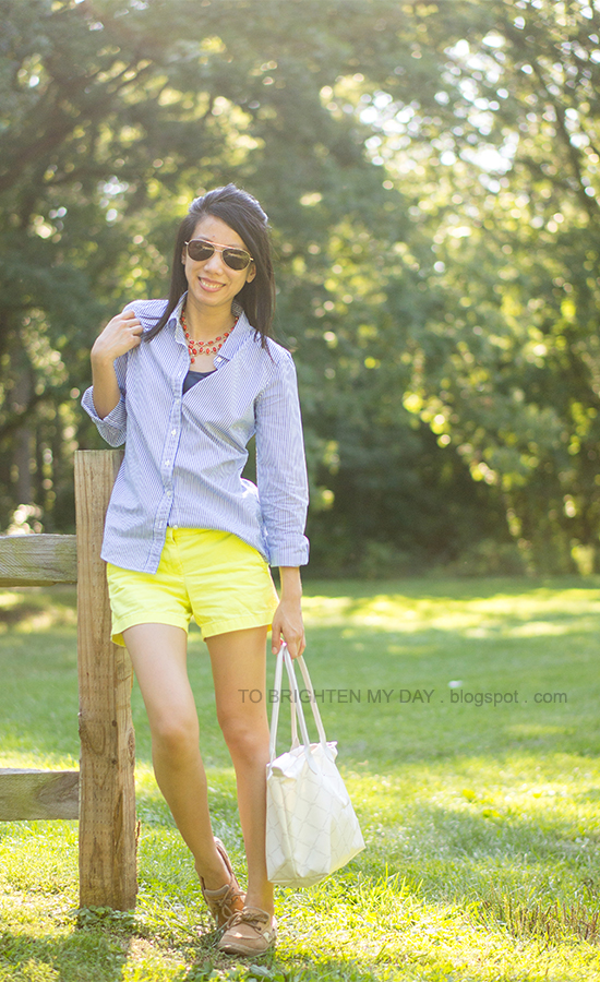 coral necklace, blue striped shirt, yellow shorts