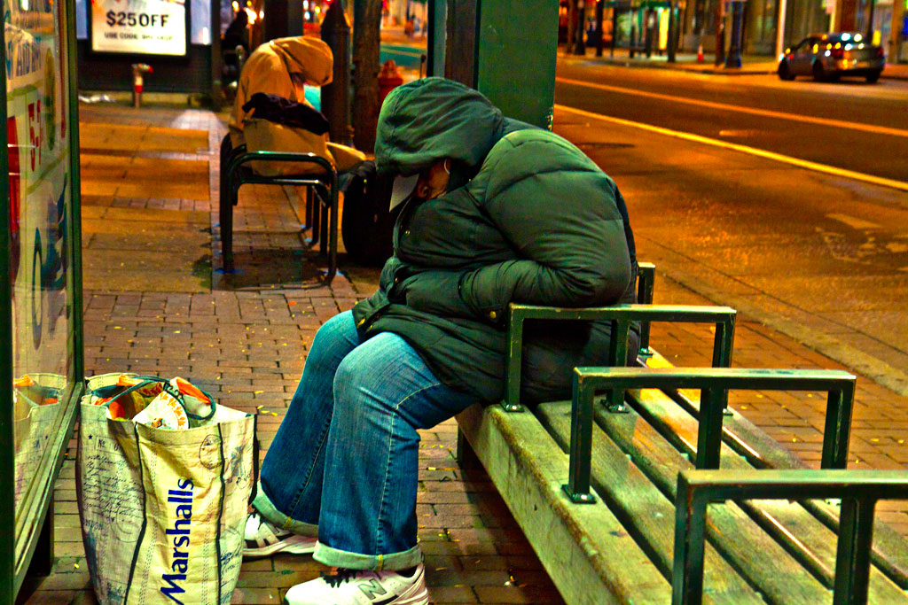 Woman-sleeping-at-bus-stop-shelter-on-9-14-14--Center-City