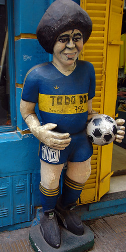Maradona, a star (and later coach) (and sometimes Go) of the  Boca Juniors team in Buenos Aires, Argentina