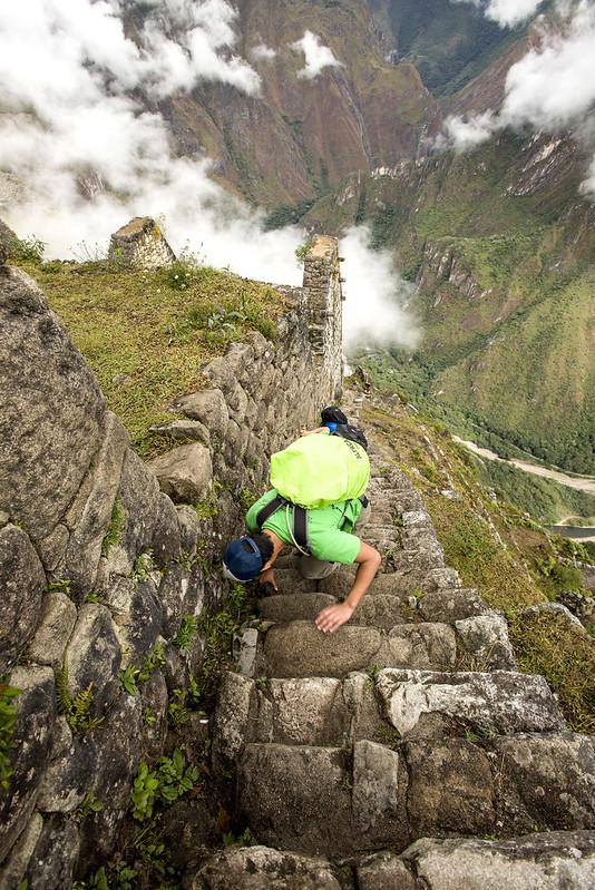 Climbing the steps of Huayna Picchu