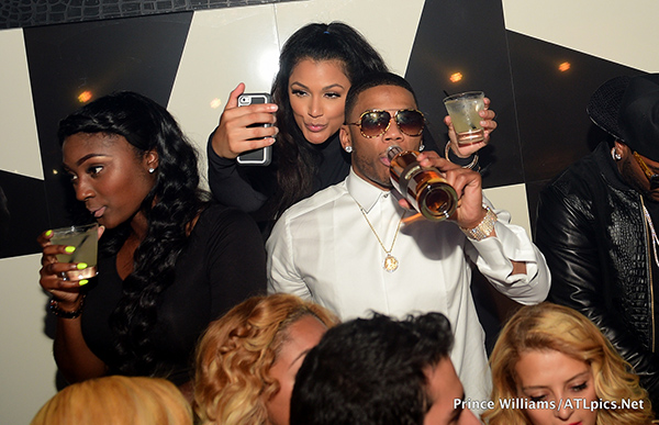 Nelly-and-Shantel-Jackson-cuddled-at-Gold-Room