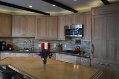 floor(0.0), cuisine classique(0.0), living room(0.0), wood flooring(0.0), kitchen(1.0), countertop(1.0), wood(1.0), room(1.0), property(1.0), interior design(1.0), design(1.0), real estate(1.0), hardwood(1.0), cabinetry(1.0),