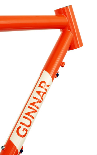 <p>Gunnar Hyper-X in Monarch Orange.  The Hyper-X, with chainstay-mounted disc brakes and light-weight tubing, is ideal for cyclocross competition, off-season training, distance riding and light touring.   Stainless steel dropouts protect the heaviest wear areas, while the handy zip-tie guides work with both hydraulic and cable actuated brakes.  This bike shows the optional 44mm head tube, allowing you to install a wide range of suspension forks.</p>