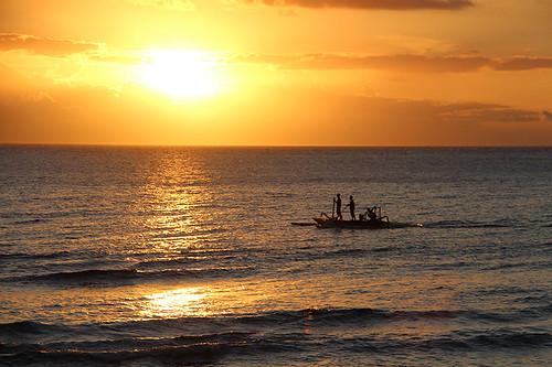 sunset paddle boat