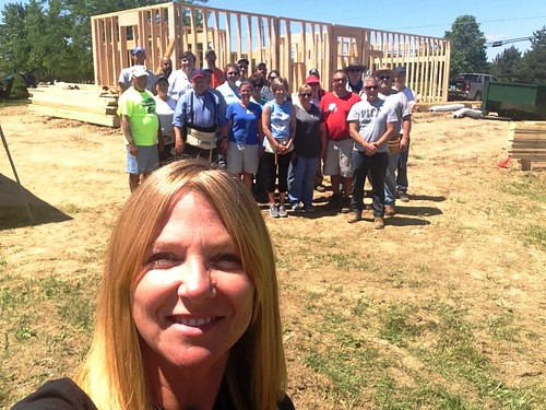 "Soon-to-be homeowner Michelle Amrine snaps a ""selfie"" with USDA Ohio Rural Development employees who spent the day working on Amrine's Habitat for Humanity site in Marysville (Union County). The house marks the first-ever built-from-the-ground-up collaboration between Habitat and Rural Development in Ohio. (USDA Photos by Michelle Amrine and Heather Hartley)"