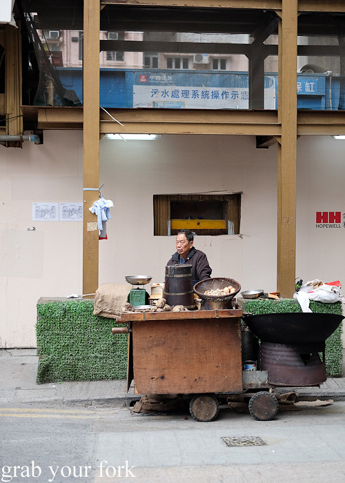 Street cart selling roasted pan-chestnuts and sweet potato in the Central district, Hong Kong