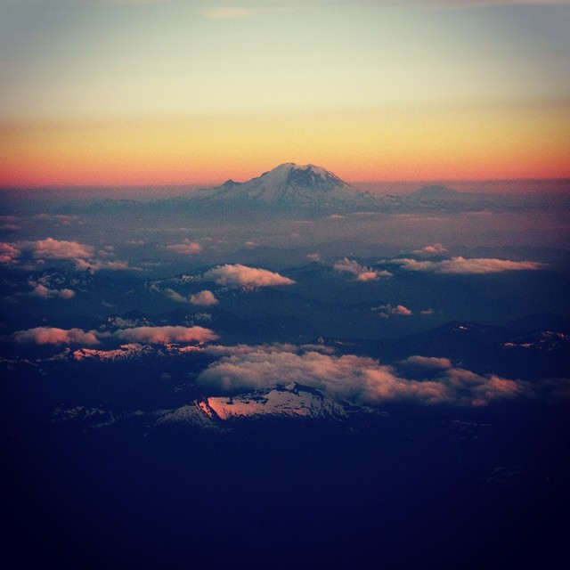 Mount Rainier.  Beautiful, right?  #flying #plane #mountrainier #mountain #sky #clouds #scenery #nature #beautiful
