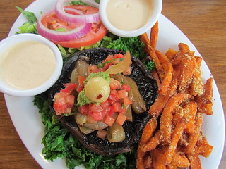 Portobello Burger Kale Style with Sweet Potato Fries at Veggie Grill