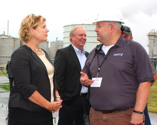 USDA Rural Business-Cooperative Service Administrator Lillian Salerno listens as Erik Chaffer, environmental health, safety and logistics manager for Three Rivers Energy, recounts the long-hoped for reopening of the ethanol plant he helped mothball in 2008 during the Great Recession. Located in rural Coshocton County, Ohio, the plant employs nearly 40 area residents and purchases corn from local farmers. (USDA photo: Heather Hartley)