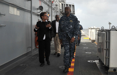 Rear Adm. Frank L. Ponds, commander of  ESG 3, speaks with Margaret Diop, Charge d'Affaires, U.S. Embassy, Trinidad and Tobago