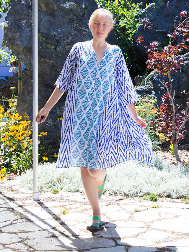 blue and white patterned summer dress in the garden
