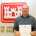 Latvian EMS officials honor USACE engineer by USACE Europe District