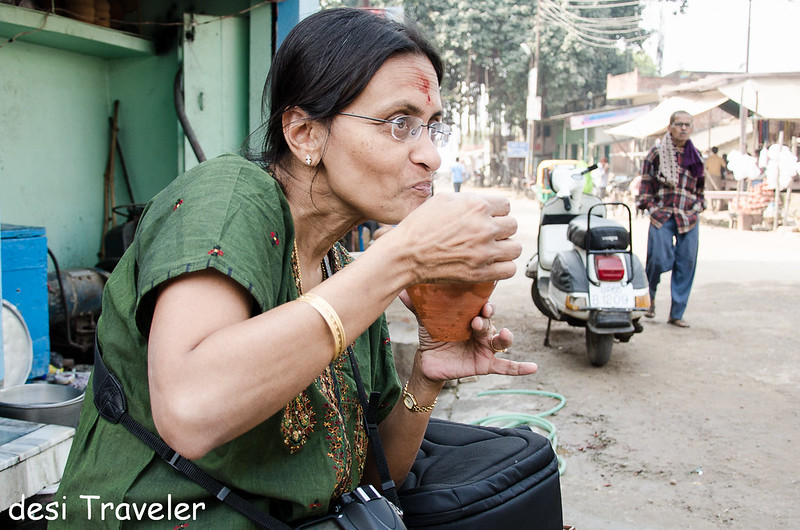 A women photographer drinking lassi in Banaras