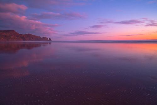 sunset sea newzealand sky seascape color colour reflection beach night clouds landscape coast colorful dusk shoreline auckland shore coastline nightsky colourful bethellsbeach