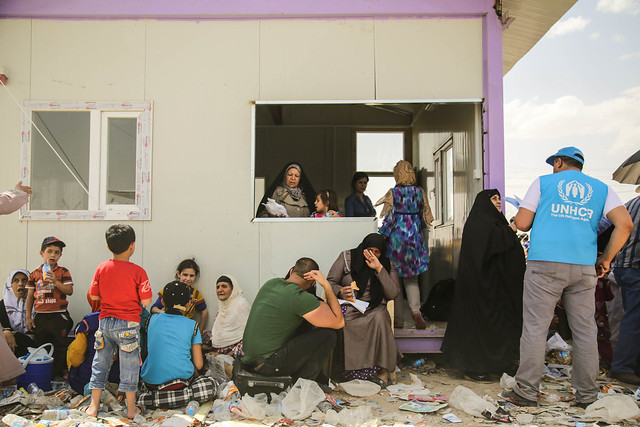 Iraqis displaced from Mosul in June, getting help from the United Nations High Commissioner for Refugees.
