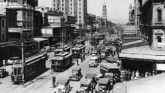 Trams head down King William St in the 1920s.