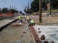 Installation of brick pavers.