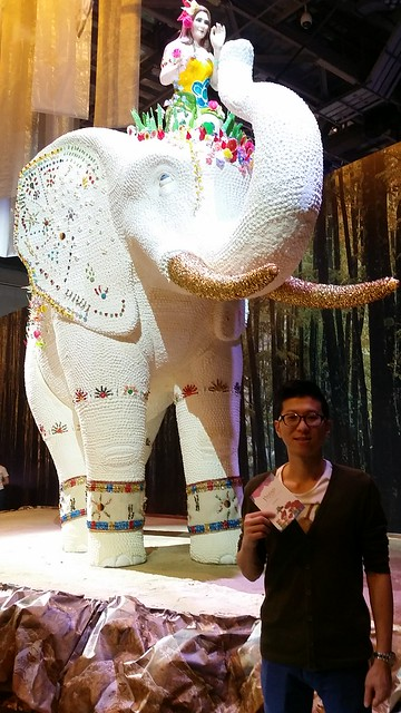Even hubby is game to take a picture with the elephant. I love the golden tusks!