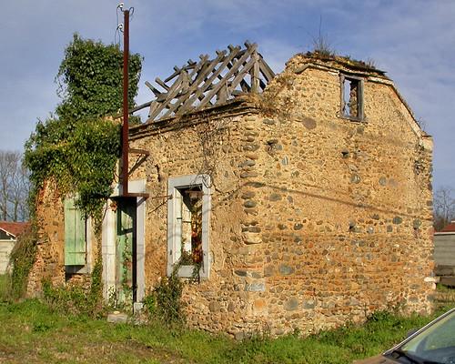 Abandoned derelict fieldstone farmhouse near Sauveterre-de-Béarn, Pyrénées-Atlantiques, France