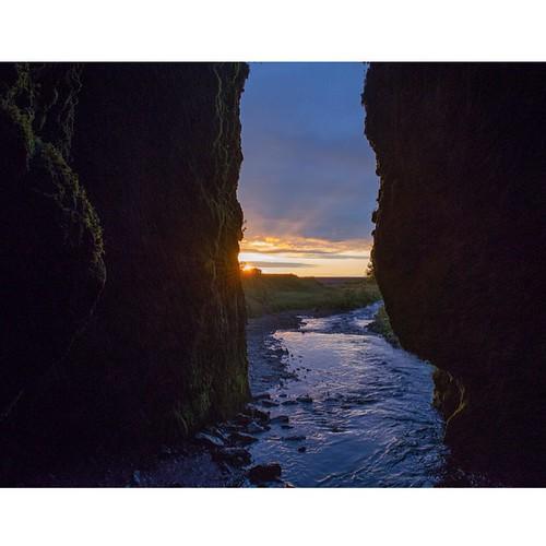 Dark cave at dusk.