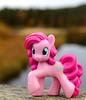 Pinkie Pie on a Bridge Railing