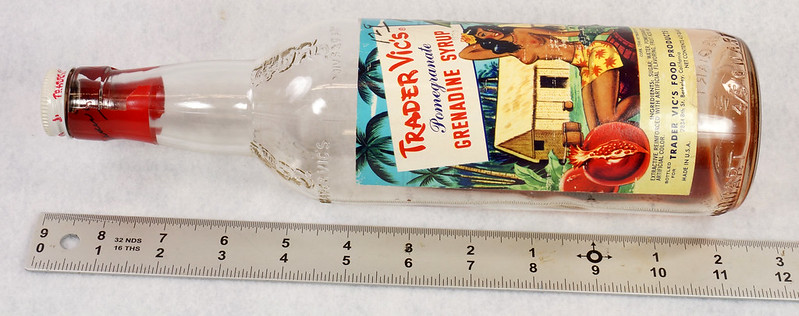 RD15320 Vintage Mid Century 1946 Bottle of Trader Vic's Pomegranate Grenadine Syrup with Topless Girl Tiki DSC09129