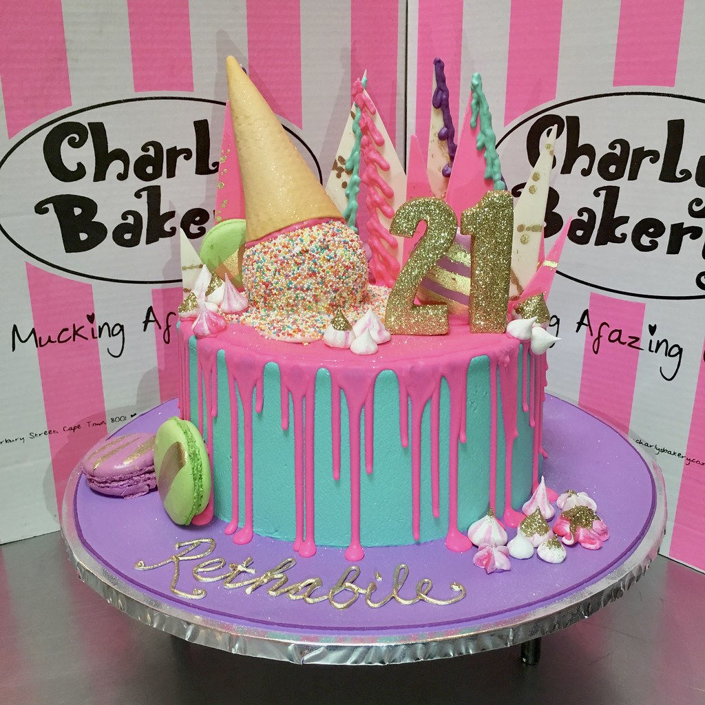 Single Tier UnBirthday Inspired 21st Birthday Cake Iced In Aqua Blue With Lumo Pink Piped