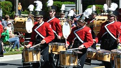 orchestra(0.0), marching band(1.0), drummer(1.0), musician(1.0), parade(1.0), musical ensemble(1.0), marching(1.0), drum(1.0), person(1.0),