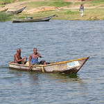 Fishermen canoeing along the Kazinga Channel, so rows into the lake at Queen Elizabeth National Park, Uganda