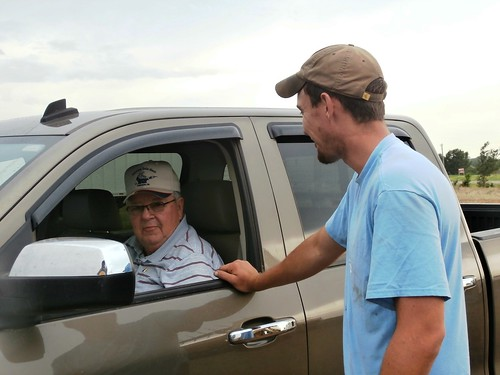 Neal and Brandon talking harvest business
