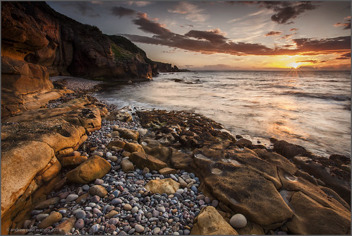 uk light sunset sea seascape reflection beach landscape scotland rocks united scottish kingdom pebbles cave moray firth andrewwatson cummingston