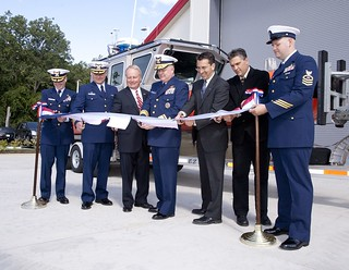 Members of the official party cut the ribbon, officially opening the new Coast Guard Station Fairport facilities in Grand River, Ohio, Aug. 15, 2014.  The new 18,000 square foot station building meets Leadership in Energy and Environmental Design standards and includes a modern command center, administrative offices, and training, dining and berthing spaces.  U.S. Coast Guard photo by Auxiliarist Mark Galan