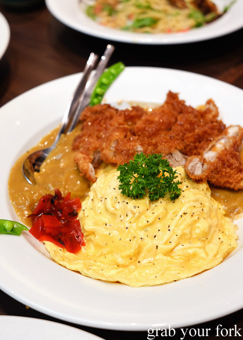 Chicken katsu omelette rice with curry sauce at Pasta Goma, Sydney