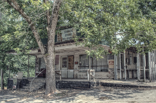 old trees usa building abandoned architecture rural vintage georgia store nikon closed unitedstates decay south country rusty architectural gasstation southern faded adobe boardedup generalstore frontporch derelict mica shady smalltown gaspump lightroom countrystore cherokeecounty ballground stancilsstore d7000 stgrundy