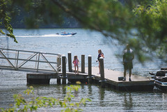 Family fishing on dock near lodges Claytor Lake State Park