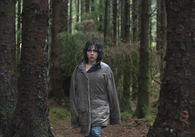 A still from late in Under the Skin where Scarlett Johansson is ragged and lonely in a forest.