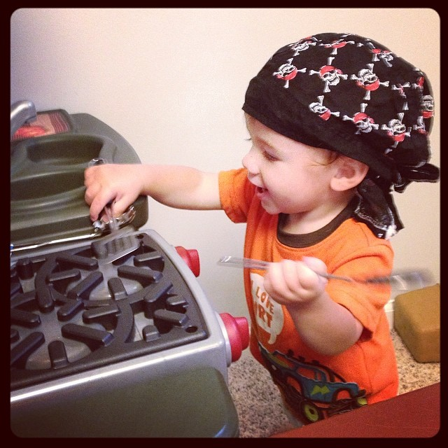 His siblings dressed him up like a pirate and then put him to work in the ship's kitchen. #11months #siblings #stevensonpartyof5 #pretend