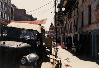 Old truck, Hindu Temple, shopping street, bicycles, apartment houses, sidewalk, sunny day, 1990 - India