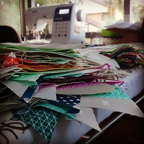 Piecing, piecing, piecing. #secretproject #ofDOOM and in the background my hard-driven Brother NS50 which I bought before I realised there were machines specially designed for quilting. And which is in for its first service in...um...as long as I've had i