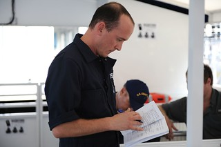 Lt. Cmdr. Marc Montemerlo, a Coast Guard vessel inspector, reviews safety guidelines Thursday, August 7, 2014, during a water taxi inspection in Jacksonville, Florida. The water taxis will be used to ferry passengers from one side of the St. Johns River to the other in the Downtown Jacksonville area. U.S. Coast Guard photo by Petty Officer 2nd Class Anthony L. Soto