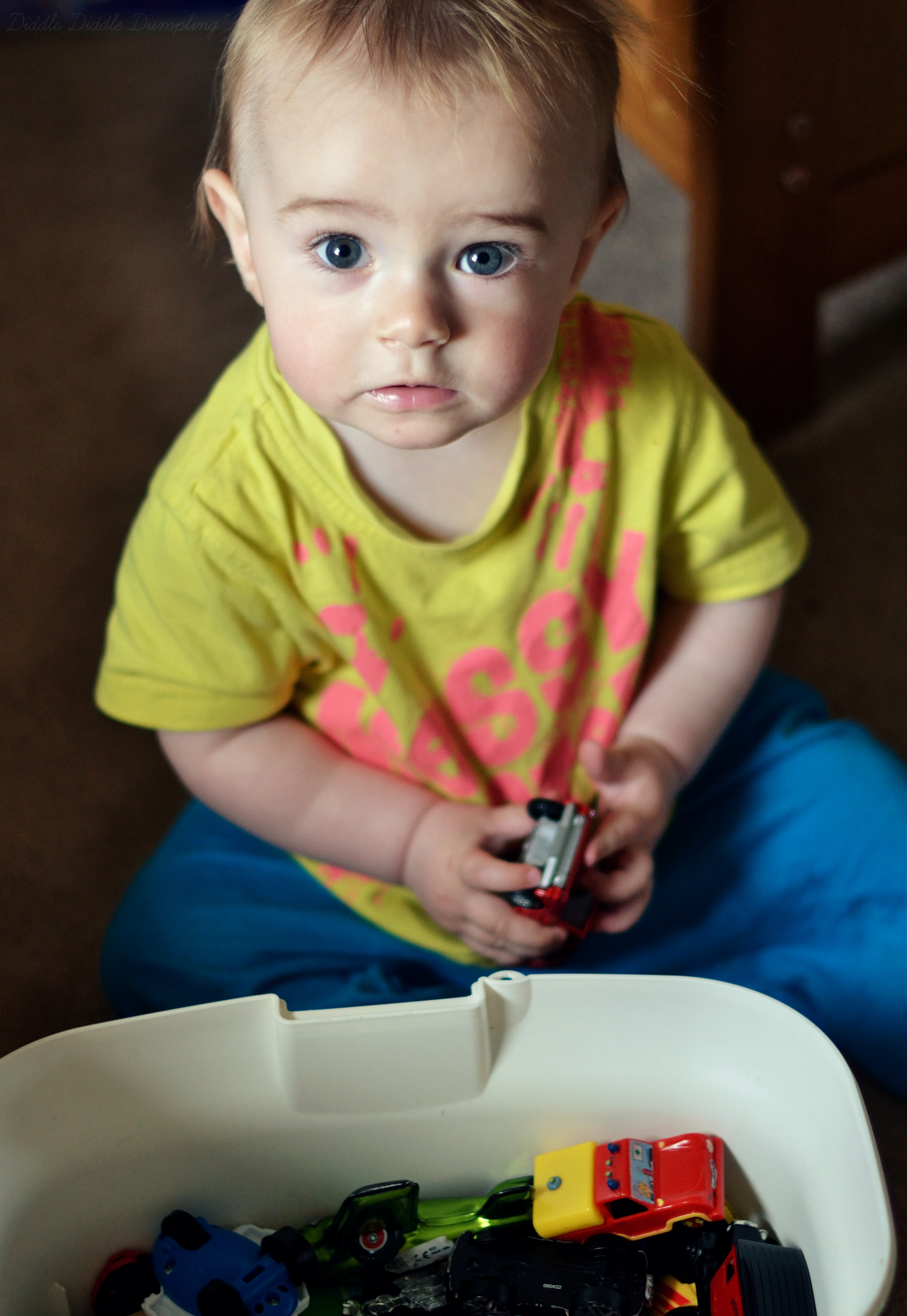 Baby David playing with the toy cars.