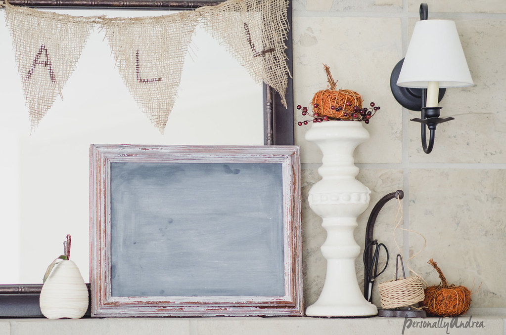 Fall mantel with mirror, chalkboard, pumpkins, books, candlesticks and burlap banner | personallyandrea.com