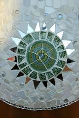 doily(0.0), art(1.0), pattern(1.0), mosaic(1.0), symmetry(1.0), flower(1.0), design(1.0), circle(1.0),