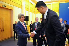 U.S. Secretary of State John Kerry shakes hands with former NBA player Yao Ming after thanking him for his activism during an anti-wildlife trafficking event on the sidelines of the sixth U.S.-China Strategic and Economic Dialogue in Beijing on July 9, 2014. [State Department photo/ Public Domain]